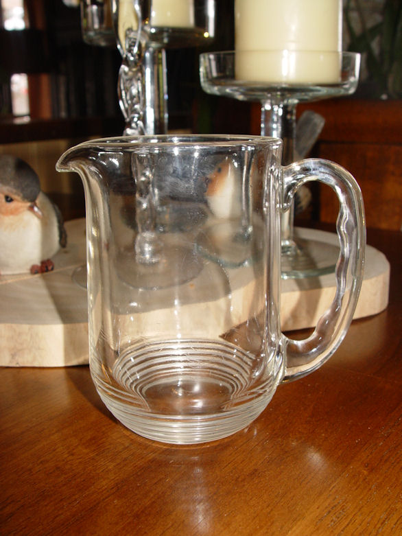 "Vintage retro 50's / 60's                                         clear glass milk or gravy                                         pitcher 5"" Tall"
